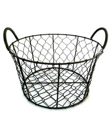 A handmade black round wire basket with combo handles